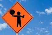 Flagman Ahead Sign
