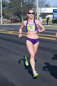JACKSONVILLE, FLORIDA - MARCH 13: Woman runner Shannon McHale, age 38, of W Simsbury, CT competes in