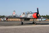PALM COAST, FLORIDA - MARCH 27: A Soviet Union Yak 52 trainer aircraft prepares for takeoff at the W
