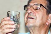 portrait of an elderly man singing