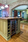 kitchen detail with island and wine refrigerator