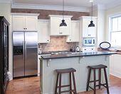 elegant kitchen with mix of granite, brick, and wood