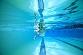 boy swimming laps, shot underwater