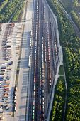 stock photo of railroad yard  - aerial view of railroad yard with trucks - JPG