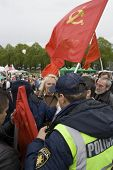 RIGA, LATVIA, MAY 9, 2009: The Police preclude to use the forbidden symbols of Soviet Union at Celeb