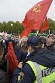 RIGA, LATVIA, MAY 9, 2009: The Police preclude to use the forbidden symbols of Soviet Union at Celeb