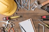 Blank Notebook And Tools Supplies On Wood Background poster
