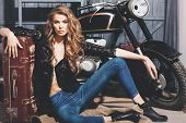Pretty Girl Biker In Erotic Shirt And Jeans On Floor poster