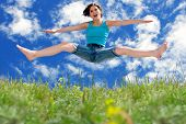 Girl Jumping To Blue Summer Sky