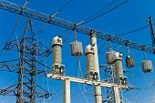 high-voltage substation on blue sky background