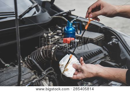 poster of Services Car Engine Machine Concept, Automobile Mechanic Repairman Hands Checking A Car Engine Autom