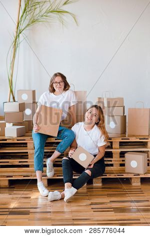 Two Young Girls Entrepreneurs Packing
