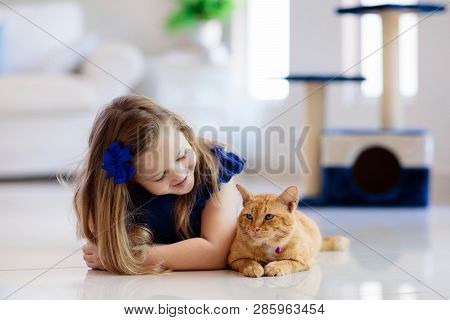 poster of Child Playing With Cat At Home. Kids And Pets.