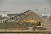 Construction Equipment With A Large Mound Of Dirt