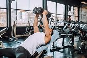 Determined Muscular Man Exercising And Doing Weight Lifting At Fitness Gym poster