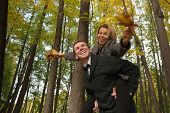 Happy Young Couple Playing With Fallen Leaves In Autumn Park poster
