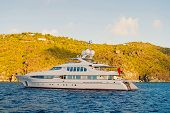 Yachting And Sailing Adventure In Gustavia, St.barts. Yacht At Sea Coast On Sunny Blue Sky. Luxury T poster