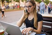 Serious Woman Freelance Social Media Content Writer Having Cell Telephone Conversation While Reading poster