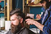 Hipster Client Getting Haircut. Barber With Hair Clipper Works On Hairstyle For Man With Beard, Barb poster