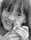 Happy child with baby duckling