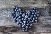 Blueberries On Rustic Wooden Cozy Background. Fresh-gathered Berries Full Of Vitamins, Good For Diet poster