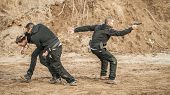 Bodyguard And Vip People Security Protection. Combat Gun Shooting Training On Outdoor Shooting Range poster