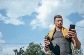 Male Athlete, Summer Sports Field Hand Smartphone, Writes Message Internet, App Pulse Workout Activi poster