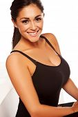 Beautiful smiling happy woman with large breasts in black leotard isolated on white