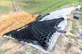 Slope Erosion Control Grids, Sheets And Earth On Steep Slope poster