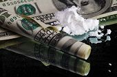 image of methadone  - Cocaine drugs heap still life on a mirror with rolled 100 dollar bank note - JPG