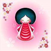 Spring japanese kokeshi doll with sakura flowers ornament