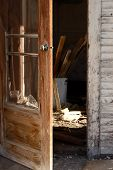 stock photo of screen-porch  - The porch of an abandoned house with rubble visible on the floor - JPG