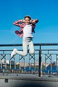 Like A Rock Star. Little Girl Jumping To Music. Small Happy Child Listening To Music. Little Child E poster