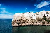 Houses In The Town Polignano A Mare Built Upon A Cliff Above The Mediterranean Sea In Puglia At The  poster
