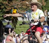 Man Rides Unicycle With Parrott