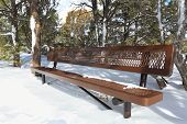 Park Bench in Winter Snow