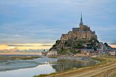 stock photo of tide  - Mont Saint Michel city at sunset - JPG