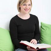 Smiling Woman Enjoying Her Book