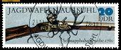 Vintage  Postage Stamp. Spring-cock Gun. 1780.