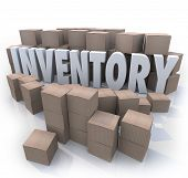 A surplus or oversupply of products in cardboard boxes in a stockroom or warehouse with the word Inventory in the mess of box piles and stacks