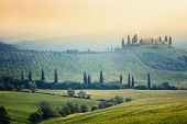 foto of farmhouse  - Scenic view of typical Tuscany mist landscape - JPG