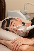 image of cpap machine  - Man with sleeping apnea and CPAP machine - JPG