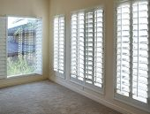 White plantation style wood Shutters for luxury Interior Design in condo.