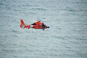 ATLANTIC CITY, NJ - AUGUST 24: US Coast Guard HH-65A Dolphin helicopter drops rescue diver during re