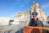 BERLIN - NOVEMBER 3: Protester in front of the Bundestag on November 3, 2011 in Berlin, Germany. Cit