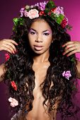 Elegant mulatto girl with circlet of flowers