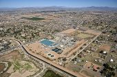 stock photo of superstition mountains  - Water Treatment Facility Expansion under sunny skies - JPG