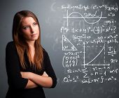 picture of mathematics  - Beautiful young school girl thinking about complex mathematical signs - JPG