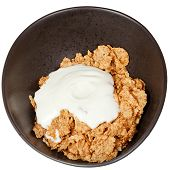 Top View Of Yoghurt Into Bowl Of Cereal