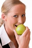 Young Woman Is Eating A Green Apple